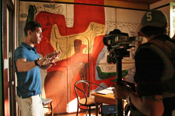 E.1027 001 Marco filming at Eileen Gray's Villa for Gray Matters. Copyright MoJo Entertainment, LLC. 2014. All Rights Reserved.